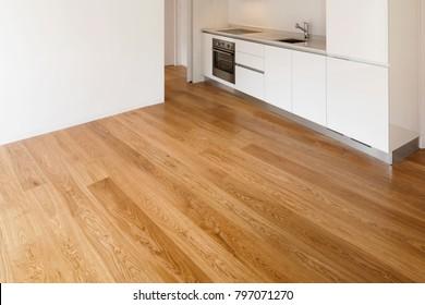 Modern kitchen. Parquet floor and wooden beams