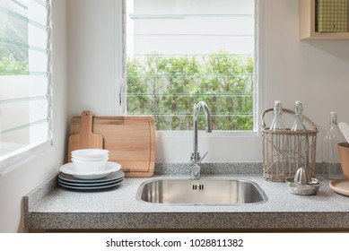 modern kitchen room with sink on counter, interior design concept