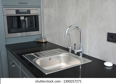Modern kitchen sink, water tap and chrome faucet for kitchen basin