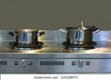 Modern kitchen with stainless steal pot on the counter and stoves interior furniture contemporary in house.