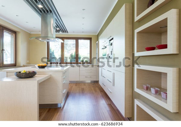 Modern kitchen with white fitted cabinets and a kitchen island