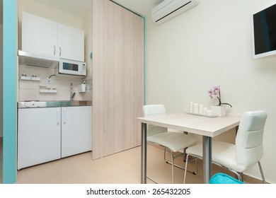 modern kitchenette  and dining room