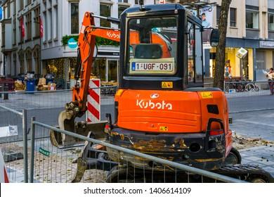 Modern Kubota excavator at a construction site in antwerp city, Antwerpen, Belgium, April 23, 2019