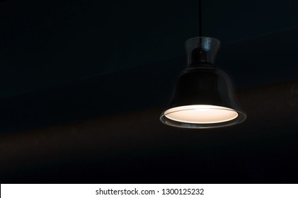 modern lamp hanging from the ceiling with copy space. Dark Tone