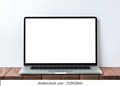 Modern laptop with clear white screen. Close up