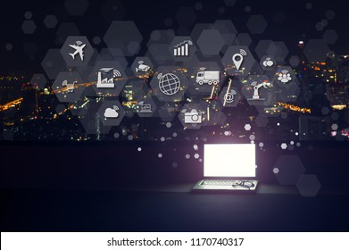 Modern laptop with Internet of things (IOT) objects icon connecting together coming out monitor, Internet networking concept, Connect global wireless devices with each other.