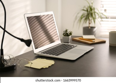 Modern laptop on office table. Stylish workplace