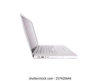 Modern laptop from the side shot in studio over a white background