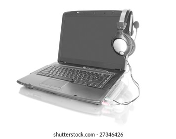 modern laptop with stereo headset isolated on white