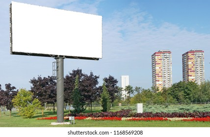 A modern large canvas blank billboard is installed in a standard sleeping city area near the highway. Panoramic collage from severap outdor sunny day photos