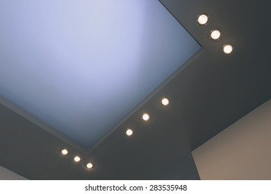 Modern layered ceiling with embedded lights, view 2