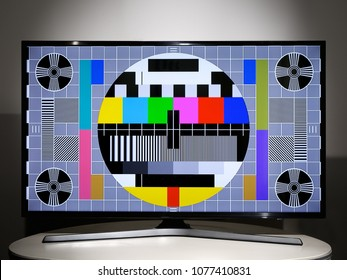 Modern LCD television with multi colored geometric test pattern