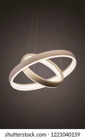 Modern led pendant light lamp illuminated, fashionable designer chandelier in the form of rings.