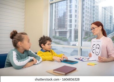 Modern lesson. A young teacher using emoji pictures during her lesson