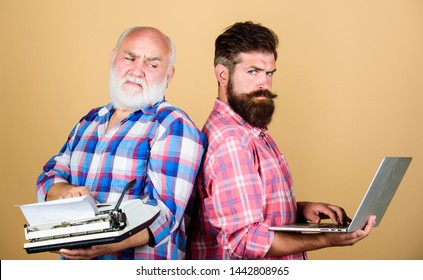 Modern life and remnants of past. Digital technologies. Battle of technologies. Master new technologies. Men work writing devices. Old generation. Senior man with typewriter and hipster with laptop.