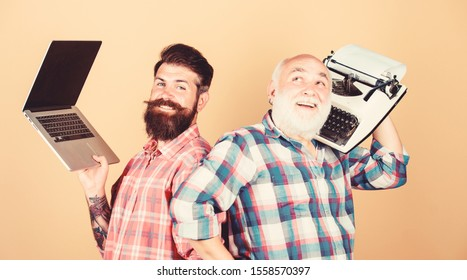 Modern life and remnants of past. Senior man with typewriter and hipster with laptop. Master new technologies. Men work writing devices. Digital technologies. Battle of technologies. Old generation.