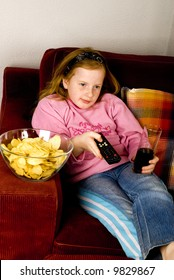 modern life while looking television with junkfood and cola