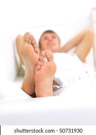Modern lifestyle - macro of man's feet, man resting