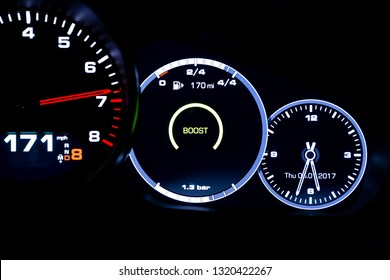 Modern light car mileage (dashboard, milage) isolated on a black background. New display of a modern car. 171 mph. Boost.