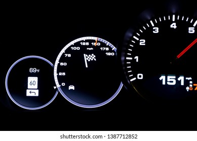 Modern light car mileage (dashboard, milage) isolated on a black background. New display of a modern car. 151 mph.