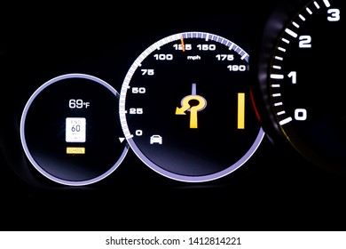 Modern light car mileage (dashboard, milage) isolated on a black background. New display of a modern car. End 60 mph limit. School.