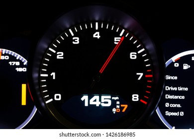 Modern light car mileage (dashboard, milage) isolated on a black background. New display of a modern car. 145 mph.