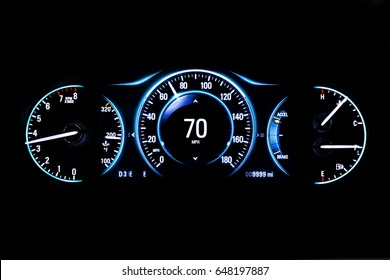 Modern light car mileage (dashboard, milage) isolated on a black background. New display of a modern car. RPM, Fuel indicator and temperature. 70 mph.