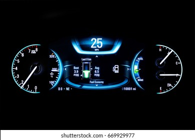 Modern light car mileage (dashboard, milage) isolated on a black background. New display of a modern car. RPM, Fuel indicator and temperature. Fuel economy. 25 mph.
