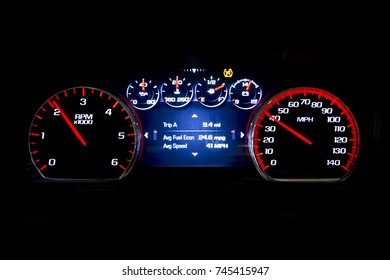 Modern light car mileage (dashboard, milage) isolated on a black background. New display of a modern car. Avg fuel econ, Avr speed.