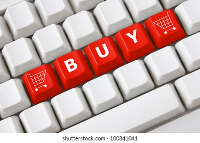 Modern light computer keyboard with a buy text and shopping cart symbol on buttons. Shopping concept