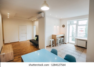 modern light interior. studio apartment. apartment with white walls and ceiling.