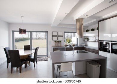 Modern and light kitchen with dining room