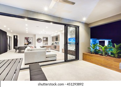 Modern living room is attached to the patio area from the outside through the glass door