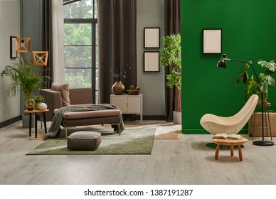 Modern living room concept with grey armchair and wooden working table style, grey and green wall background style.