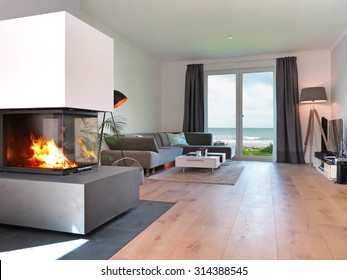 modern living room with fireplace and a view to the sea