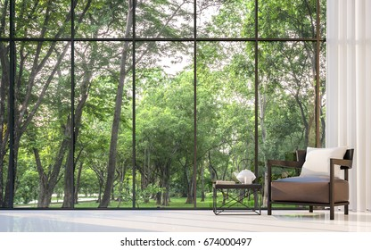Modern living room with garden view 3d rendering Image.There are large window overlooking the surrounding garden and nature