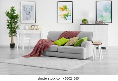 Modern living room with grey couch