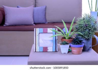 Modern Living room interior design with sofa, flower vase, photo frame / Home decoration & renovation concept