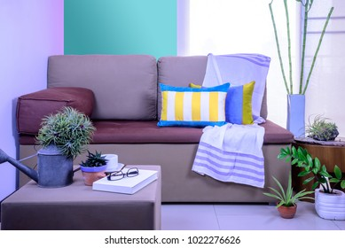 Modern Living room interior design with sofa, flower vase & throw pillow / Home decoration & renovation concept