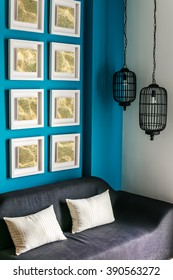 Modern living room Interior design. Small pictures on blue wall
