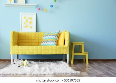 Modern living room interior design with yellow sofa