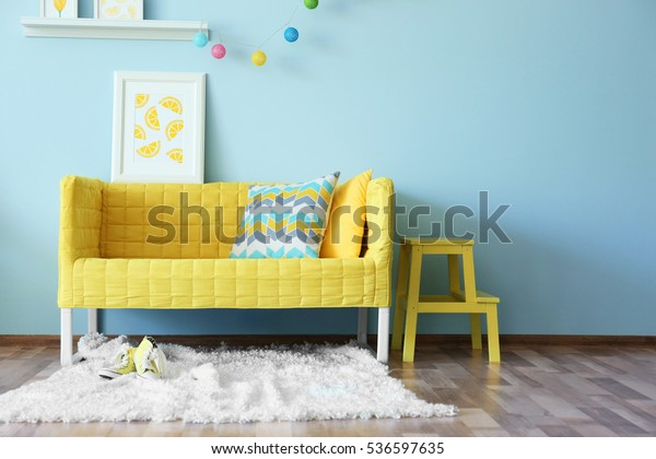 Modern living room interior design with yellow sofa