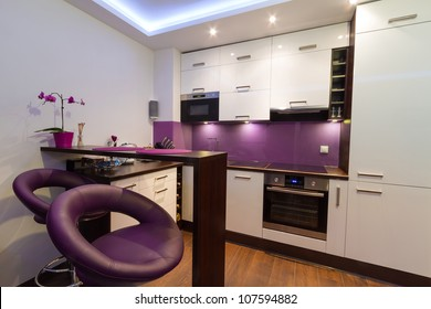 Modern living room interior with kitchen
