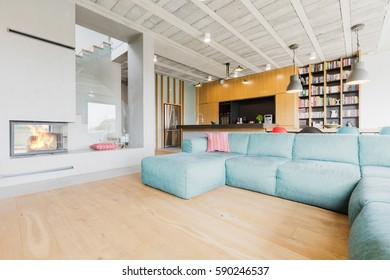 Modern living room and kitchen in the background