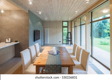 Modern living room with a kitchen and panoramic windows