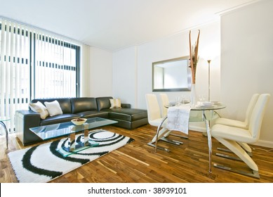 modern living room with leather sofa and dining table