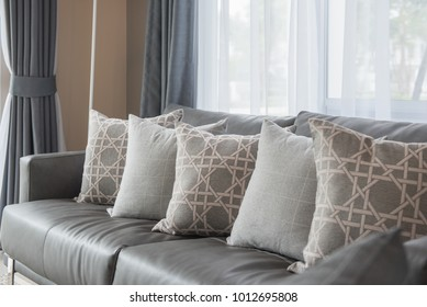 modern living room with row of pillows on grey sofa, interior design concept