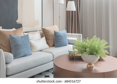 modern living room with set of pillows on sofa, interior design concept