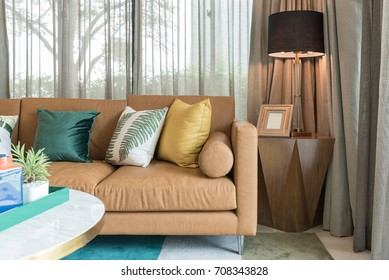 modern living room style with set of pillows on brown sofa, interior decoration design concept