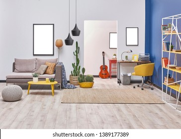 Modern living room style with white and blue wall background, yellow detail furniture and grey sofa, decorative lamp.